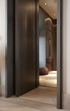 "Wooden FritsJurgens PivotDoors. ""La Ligne"" Doors by Marcel Wolterinck for specialist Bod'or. #invisiblehinges #pivotdoors"