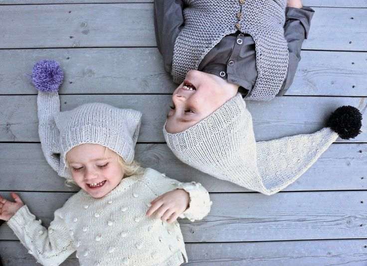 Funny sibling hats. Coloured pompoms are a simple way of using up left over yarns.