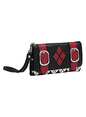 <div>Keep your wallet close with this wristlet strap. You never know what kind of hooligans could be out there. This faux leather wallet from DC Comics is inspired by Harley Quinn's classic black and red jester outfit. The main body is black and white diamond plaid with a black flap closure featuring two red buckle straps, a red diamond embellishment on front and a spade and Harley's mallot on back. Inside are 5 card slots with a clear ID display and an interior zip…