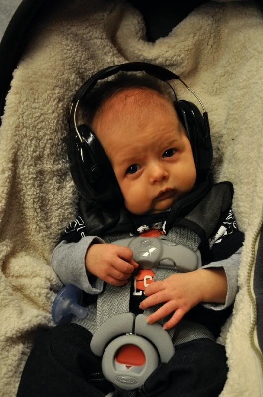 If you can find them locally....noise-cancelling headphones can protect itty bitty ears.  SXSW can get noisy!