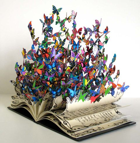 David Kracov... Imagine that to be all real butterflies coming out of the book... amazing. Its sooo beautiful