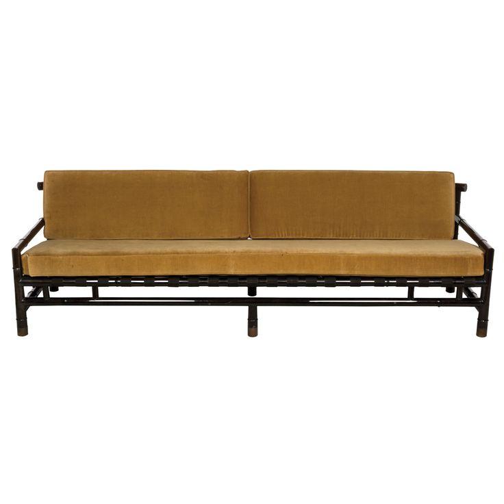 Frank Kyle. Sofá de tres plazas.  Elaborado en madera y mimbre.  Diseño a manera de bambú.  Con respaldos y asientos desmontables en tapicería de terciopelo color amarillo.