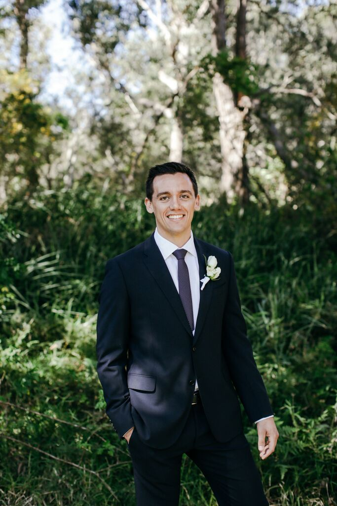Groom in classic black suit // Photos by Lara Hotz Photography
