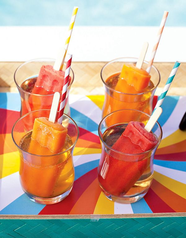 Popsicle Cocktails. Try a gourmet version with unique flavors or an adults only version with your favorite liquor. Pictured here are fun fresh fruit Popsicles set in a sparkling wine and/or Champagne spritzer.
