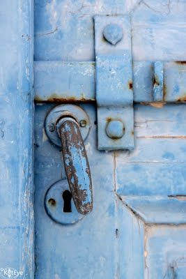 Blue door in Greece. by Kat Sloma