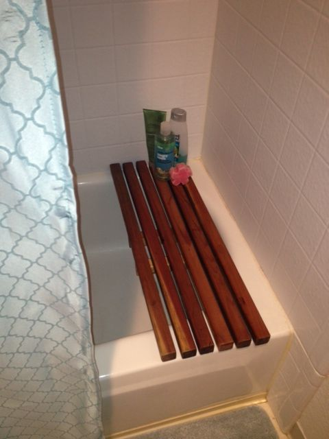 DIY 'spa' bath bench. 1x1 redwood planks are cheap at Home Depot! Hint: be sure to seal or use a very water-repellent stain, as the Minwax I used gradually drips off into the tub