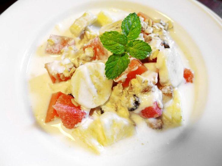 Breakfast Treat: Toasted Muesli with Yoghurt, Milk, Honey and Tropical Fruit