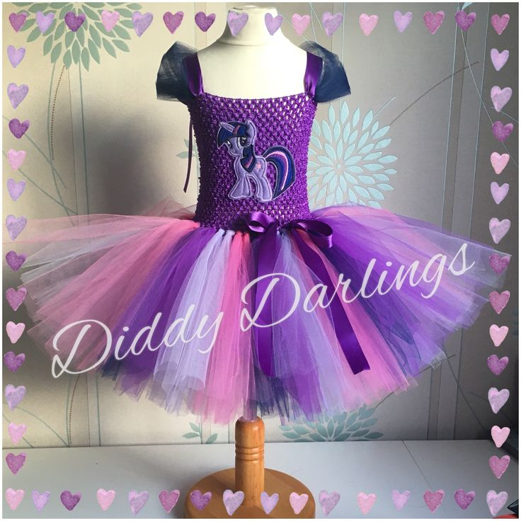 Twilight Sparkle Tutu Dress. My Little Pony Tutu Dress. Beautiful & lovingly handmade.  All characters and colours available Price varies on size, starting from £25.  Please message us for more info.  Find us on Facebook www.facebook.com/DiddyDarlings1 or our website www.diddydarlings.co.uk