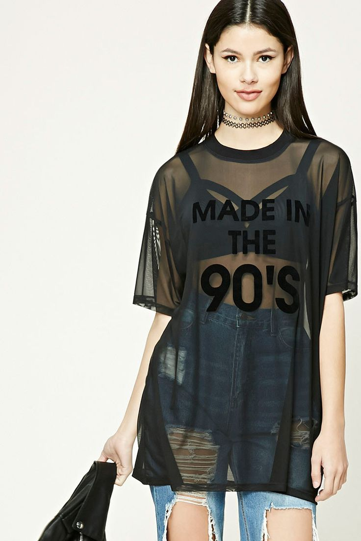 """A sheer mesh knit top featuring a tonal velvet """"Made in The 90's"""" graphic on the front, round neckline, short sleeves, and an oversized silhouette."""