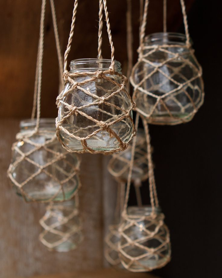 A variation of these with mason jars and twine seem simple to make, would be super cute on our back porch!