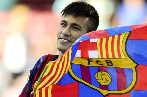 Neymar Photos Photos - Neymar looks on as he holds a FC Barcelona flag during his official presentation as a new player of FC Barcelona at Camp Nou Stadium on June 3, 2013 in Barcelona, Spain. - Neymar Unveiled as New FC Barcelona Player
