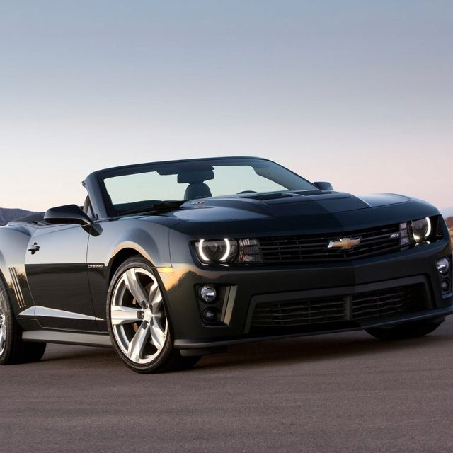 2013 Chevy Camaro ZL1 convertible in black. This thing is like a stealth panther.