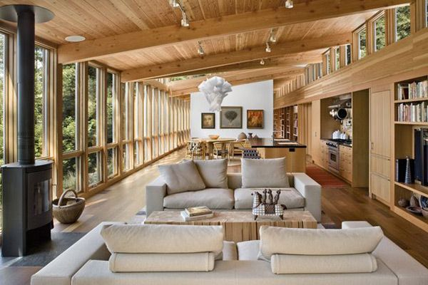 Interiors open onto these outdoor spaces seamlessly. Inside the organic 1,700-sq.-ft. forest home, an open concept house plan creates a sense of openness which is enhanced by the vast windows and natural light
