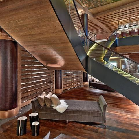 Lobby stair. wood underside of something more industrial HBA - The Alpina Gstaad, Switzerland