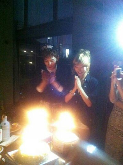 SHINee's Key and KARA's Nicole shown blowing out their birthday candles together