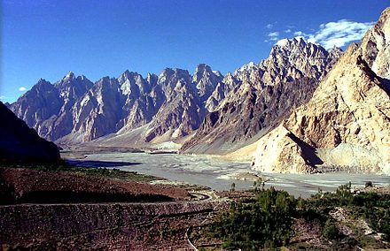 The Karakoram Highway is the highest paved international road in the world. It connects China and Pakistan across the Karakoram mountain range, through the Khunjerab Pass. It connects China's Xinjiang region with Pakistan's Gilgit–Baltistan and Khyber Pakhtunkhwa regions.  The highway, connecting the Gilgit–Baltistan region of Pakistani Kashmir to the ancient Silk Road from Kashgar, a city in the Xinjiang region of China, to Abbottabad, of Pakistan.