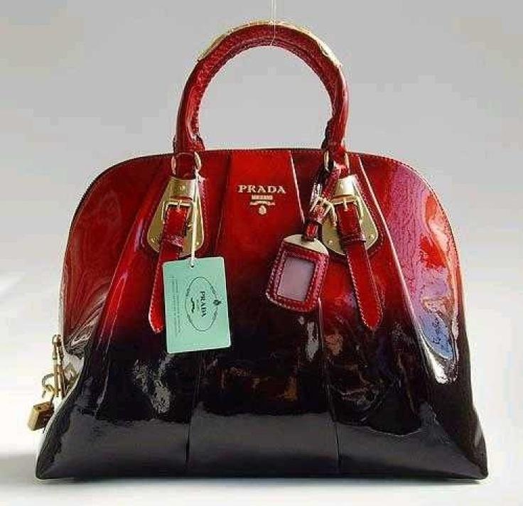 It looks like it is on fire. COVET. Prada red ombré patent handbag
