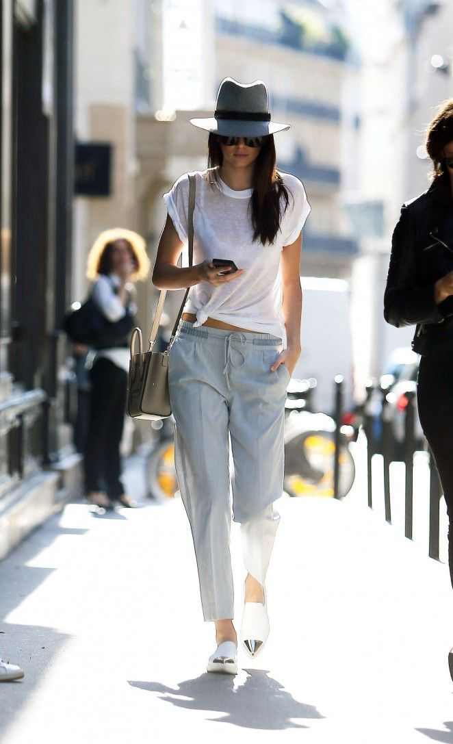 Miu Miu loafers, casual pants, white tee, hat.