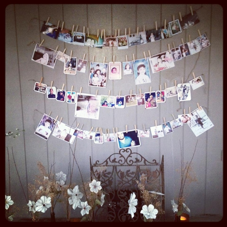 My aunt printed photos and used thin rope. Attached the pictures with close pins. The rope knotted on each end and nailed to the wall to hang.