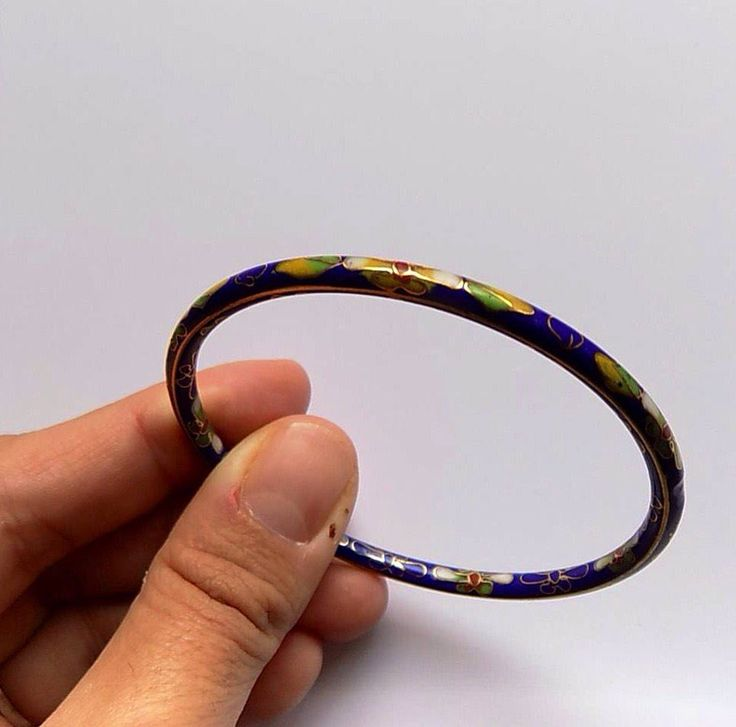 A personal favourite from my Etsy shop https://www.etsy.com/listing/543982799/blue-metal-bangle-bracelet-stacking