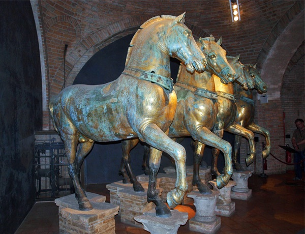 Gilded bronze horses (originals) from Basilica di San Marco Museo Marciano, Venezia, Italia. After the Fourth Crusade, Doge Enrico Dandolo sent the horses to Venice, where they were installed on the terrace of the façade of St. Mark's Basilica in 1254. The horses are thought to have first been made as part of a quadriga sculpture group at Constantinople Hippodrome.