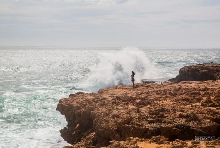 'Just north of Carnarvon the coastline becomes powerful and rugged. Huge swells hit the rocks and blow spray up to tens of meters high in the air. There is nothing but red rock cliffs for miles, with the ocean pounding them at full force. We sat here for hours listening to the crashing waves.'