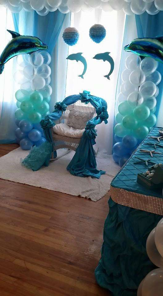 Chair of honor at a dolphin baby shower party! See more party planning ideas at CatchMyParty.com!