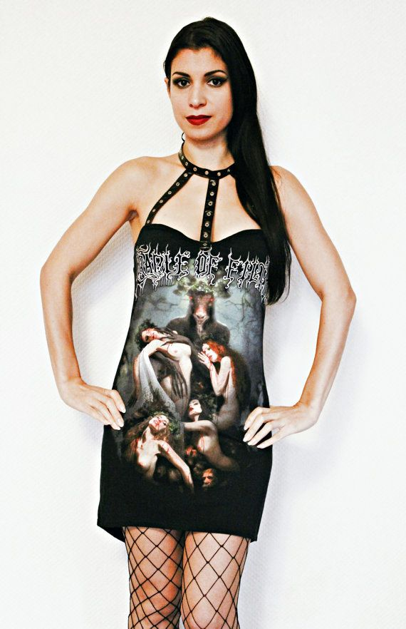 This stunning Cradle of Filth mini dress is sure to turn heads! I used an original Mens shirt and hand cut it to a feminine form using my own hand crafted patterns. Features a high low look which gradually goes longer towards the back. I gave it a sweetheart bust line and made the chest and neck straps using faux leather eyelet trim (Vegan Friendly). Ties at the back of the neck with black satin ribbon. A must have for any Cradle of Filth fan! A truly one of a kind piece! One of a kind in…