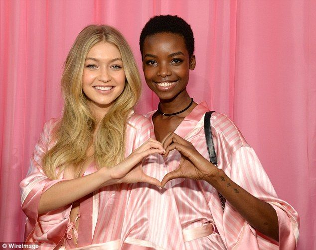 Having a laugh: Gigi and Maria Borges couldn't stop smiling as they chatted…