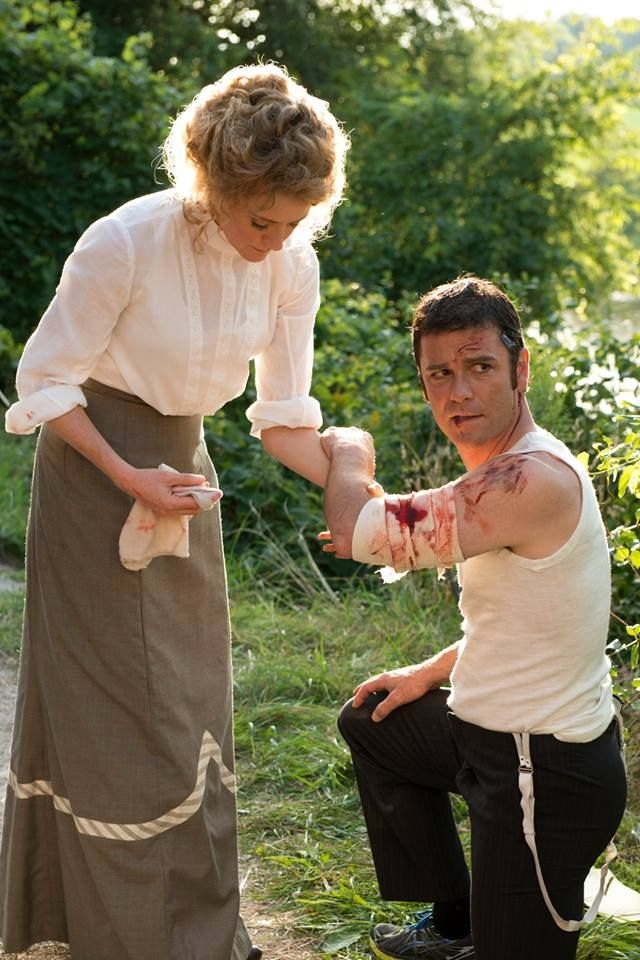Dr. Ogden (Hélène Joy) tends to Murdoch (Yannick Bisson) following his chase of Gillies. Murdoch Mysteries