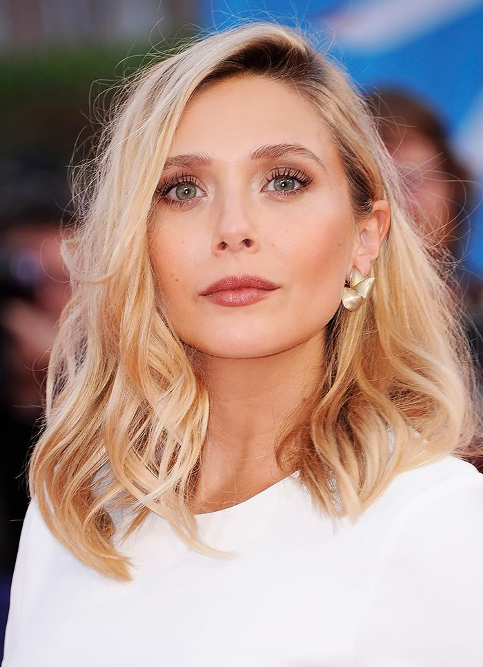 Elizabeth Olsen embodies natural beauty using neutral shadows and intense lashes