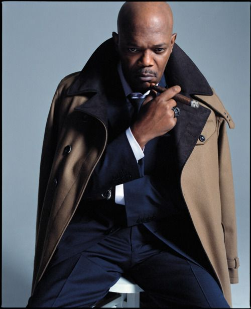Samuel L Jackson - He's cold & hot in a navy suit & white shirt. The taupe overcoat w/ navy lapel nicely complements the suit!