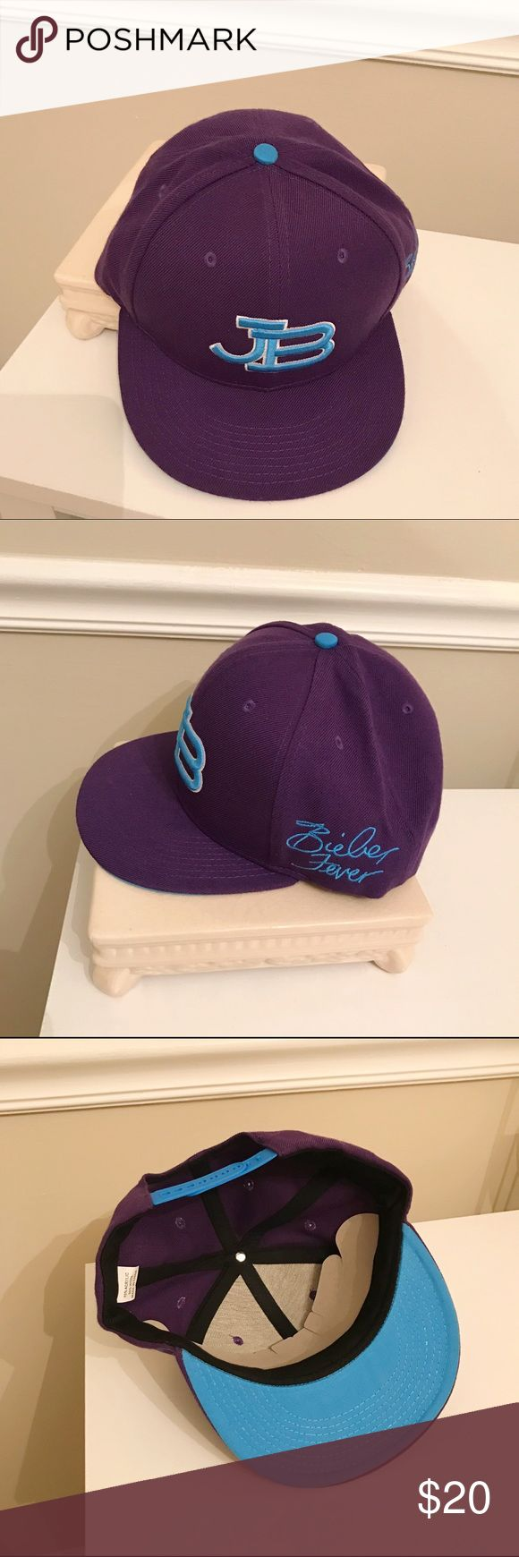 NWOT Justin Bieber SnapBack Cap JB Justin Bieber NWOT Bieber Fever Snapback Adjustable Flat Brim Purple and Blue Hat. Came from a batch of leftover concert merch wrap in plastic and brand-new. Justin Bieber Accessories Hats
