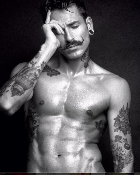 not sure about JUST a mustache, but you can't deny those tattoos or that body. NOM.