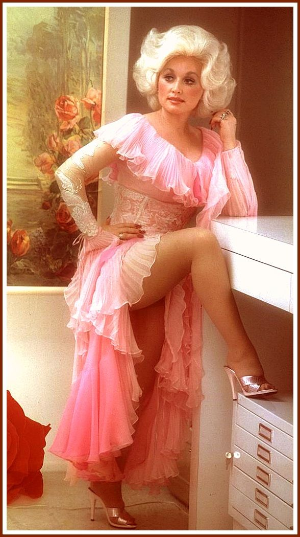 Dolly Parton in 1978 heartbreaker photo shoot flashing upskirt in pantyhose and mules.