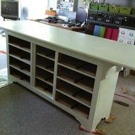 great idea for a cutting table - and old dresser with elongated surface added - drawers for storage........ I did this for my quilting room. Dresser is black and I used a solid door for the top. Love!