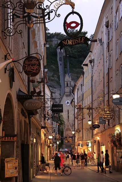Salzburg, Austria. A long and narrow street full of very old ads.