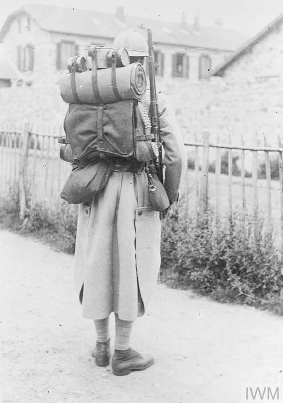 WWI, July 1917, Vincennes; A French soldier displaying uniform and equipment of an engineer/sapper. ©IWM Q 50384