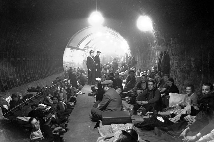 People shelter and sleep on the platform and on the train tracks, in Aldwych Underground Station, London, after sirens sounded to warn of German bombing raids, on October 8, 1940. (AP Photo)