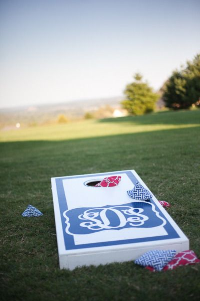 a corn hole set with our married monogram