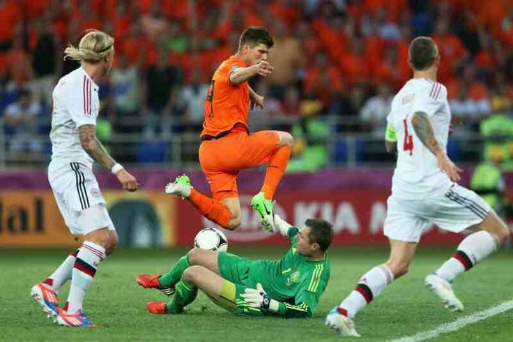 Denmark 1 Holland 0 in 2012 in Kharkiv. Stephan Andersen makes a good save from Klaas Jan Huntelaar in Group B at Euro 2012.