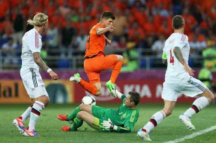 Denmark 1 Holland 0 in 2012 in Kharkiv. Stephan Andersen makes a good save from Klaas Jan Huntelaar in Group B at Euro 2012.