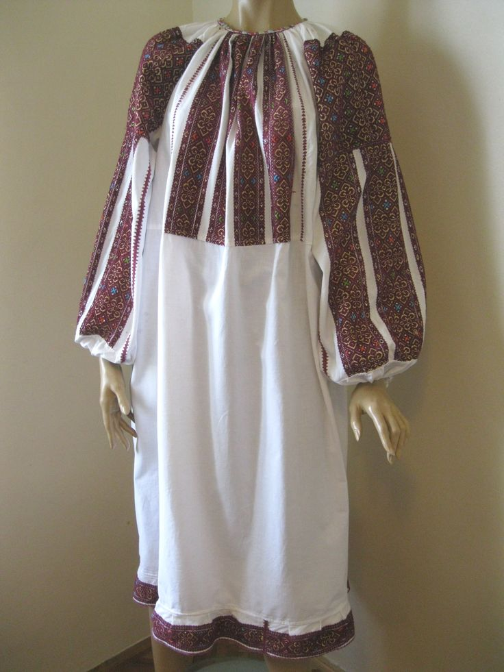 Splendid antique Romanian traditional blouse dress from Muscel area. The dress is hand woven with burgundy cotton thread on white linen. For sale at www.greatblouses.com