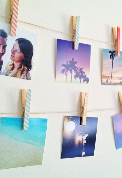 Hang photos with DIY washi tape clothespins.