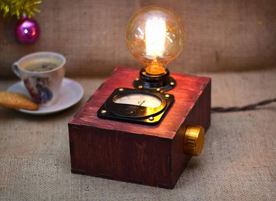 Birch plywood box, Edison bulb and Soviet voltmeter. Lamp box created from birch plywood. Polished and smoothed by hands. Coated red wood stain and beeswax. The product has a Soviet voltmeter (1966). The device is in working and shows voltage mains (not precisely). This lamp has a