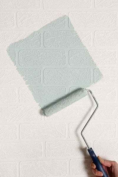 Maybe an accent wall in the office?  Graham & Brown Brick Wall Paintable Wallpaper - Urban Outfitters