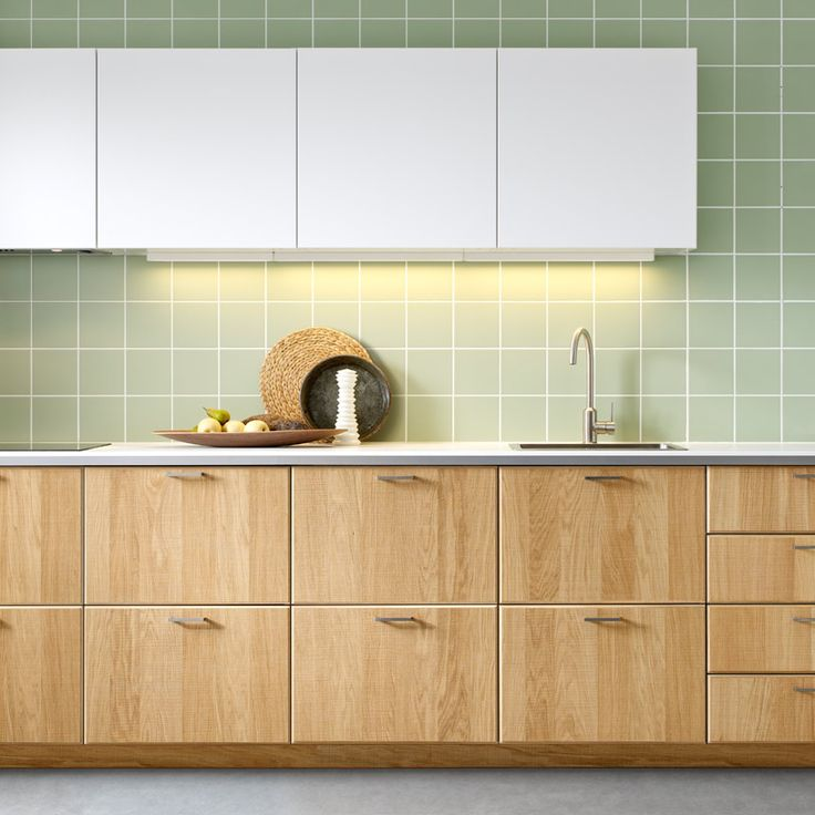 Modern light wood and white finish IKEA kitchen with white worktops