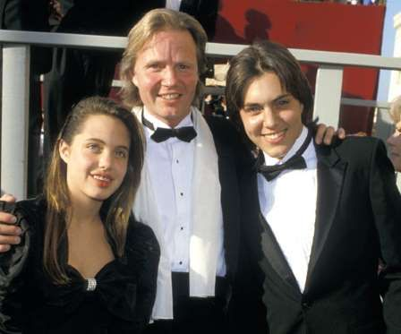 In 1988, Angelina Jolie, Jon Voight, and James Haven walked the red carpet together as a family. - Getty