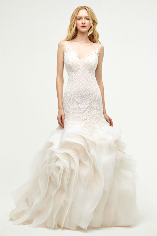 i dont like lace but id do it if it meant i could wear this jenny-lee-wedding-dresses-6-11092014nz