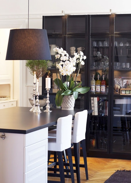 kitchen island and glass doored cabinets